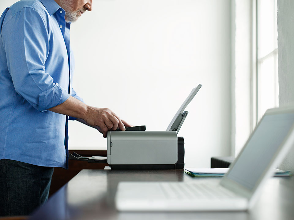 man using printer