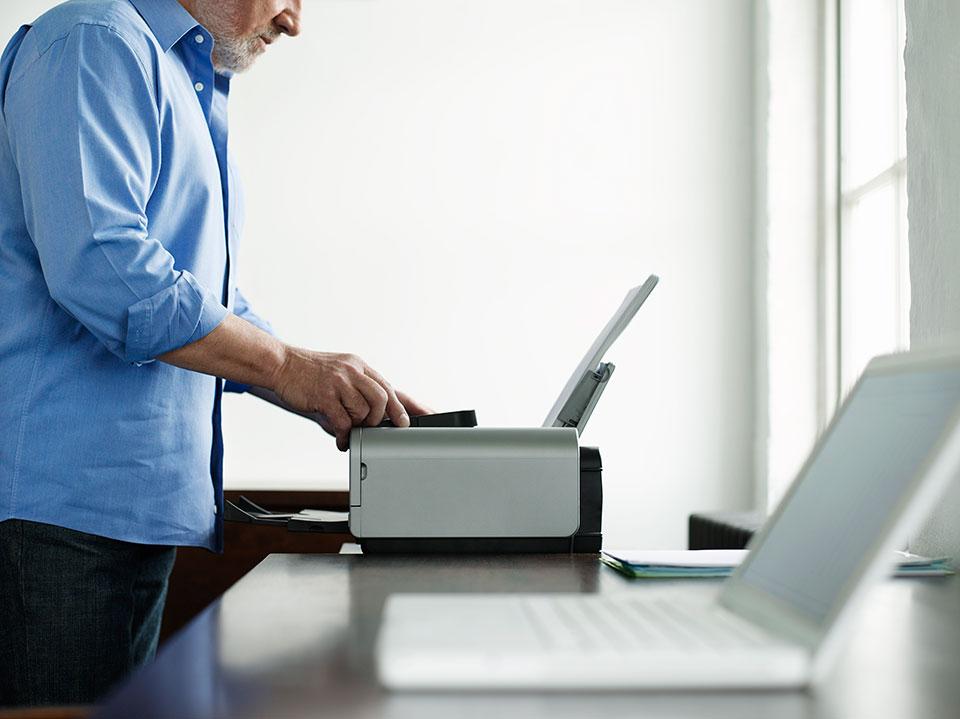 man_using_printer